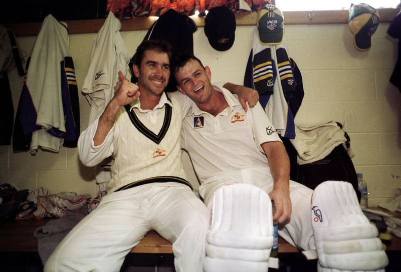 Justin Langer and Adam Gilchrist celebrate their 243 run partnership at the Bellerive Oval in 1999