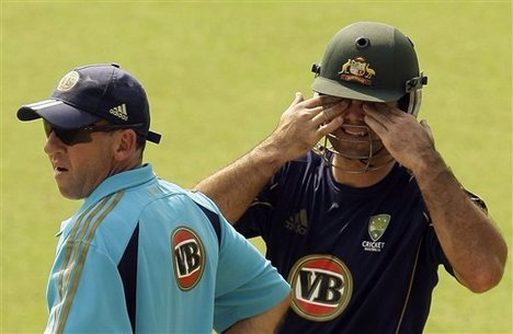 Ricky Ponting and Tim Nielsen cannot bear to look as Nathan Hauritz wheels away in the nets