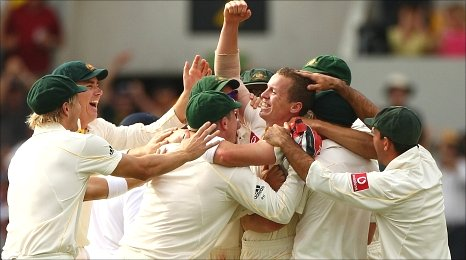 Peter Siddle is surrounded by gleeful team mates after his hat-trick at the Gabba