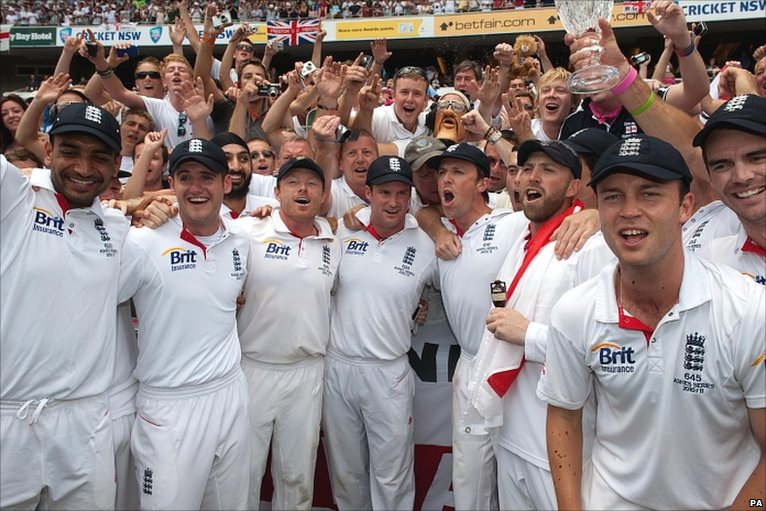 England's players celebrate with the delirious Barmy Army