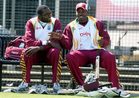 Sulieman Benn and Chris Gayle chew the fat - they are both key to West Indies' WC hopes