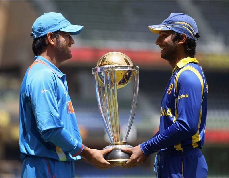 They've both got a hand on the trophy now, but will it be MS Dhoni or Kumar Sangakkara who lifts the World Cup on Saturday