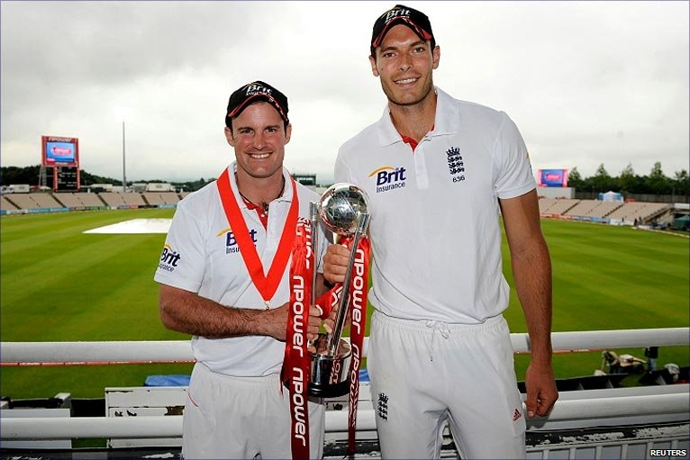 Andrew Strauss and the world's tallest man accept the trophy after beating Sri Lanka 1-0