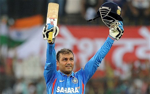Virender Sehwag salutes the crowd in Indore after beating Sachin Tendulkar's ODI record for highest score