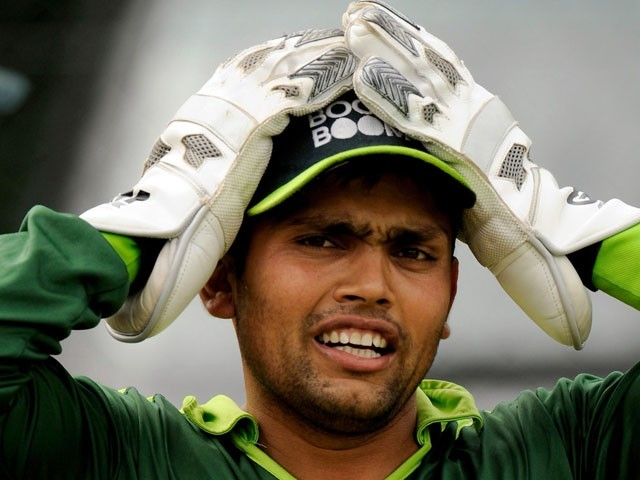 Kamran Akmal watches the video of his performance at Sydney in 2010 for the first time