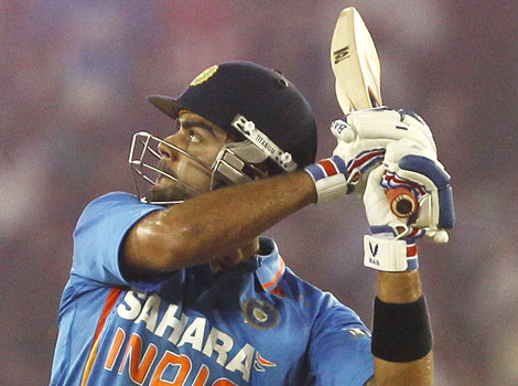 Virat Kohli hits umpire Sudhir Asnani into the stands after being given out in the 3rd ODI in Ahmedabad