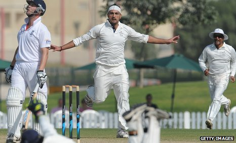 The ICC Combined XI's Hamid Hassan celebrates the wicket of Jonathan Trott as England struggle in Dubai
