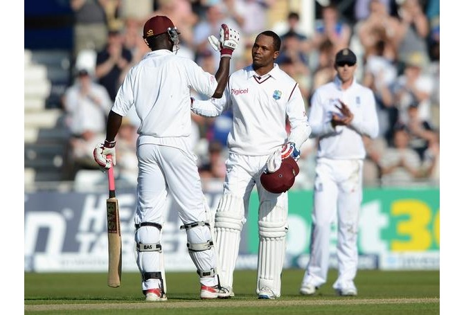 Darren Sammy and Marlon Samuels take time out to celebrate during their record partnership at Trent Bridge